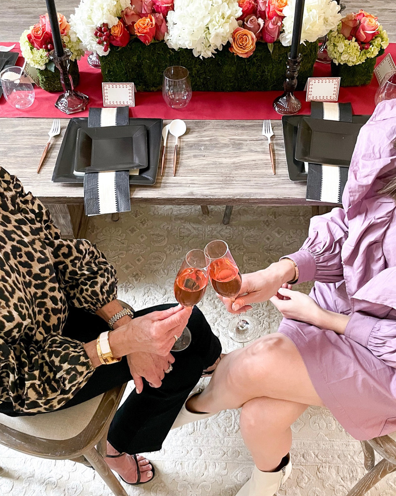 two women toasting with rosé champagne