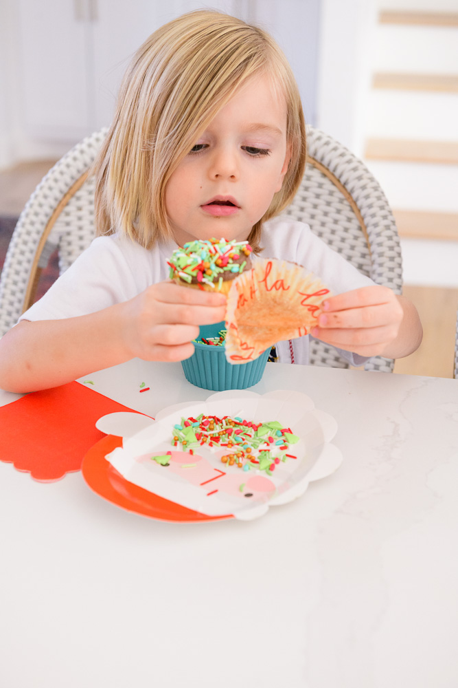 toddler boy about to eat decorated cupcake