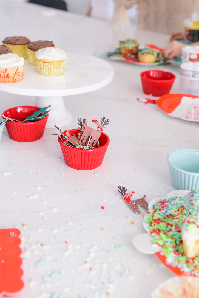 messy holiday cupcake decorating scene