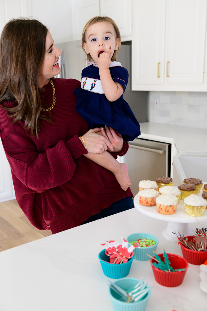 mom with baby eating cupcake