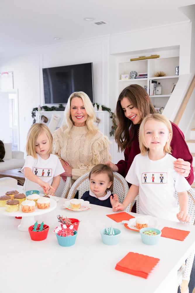 mom and grandmother with three toddler boys cupcakes