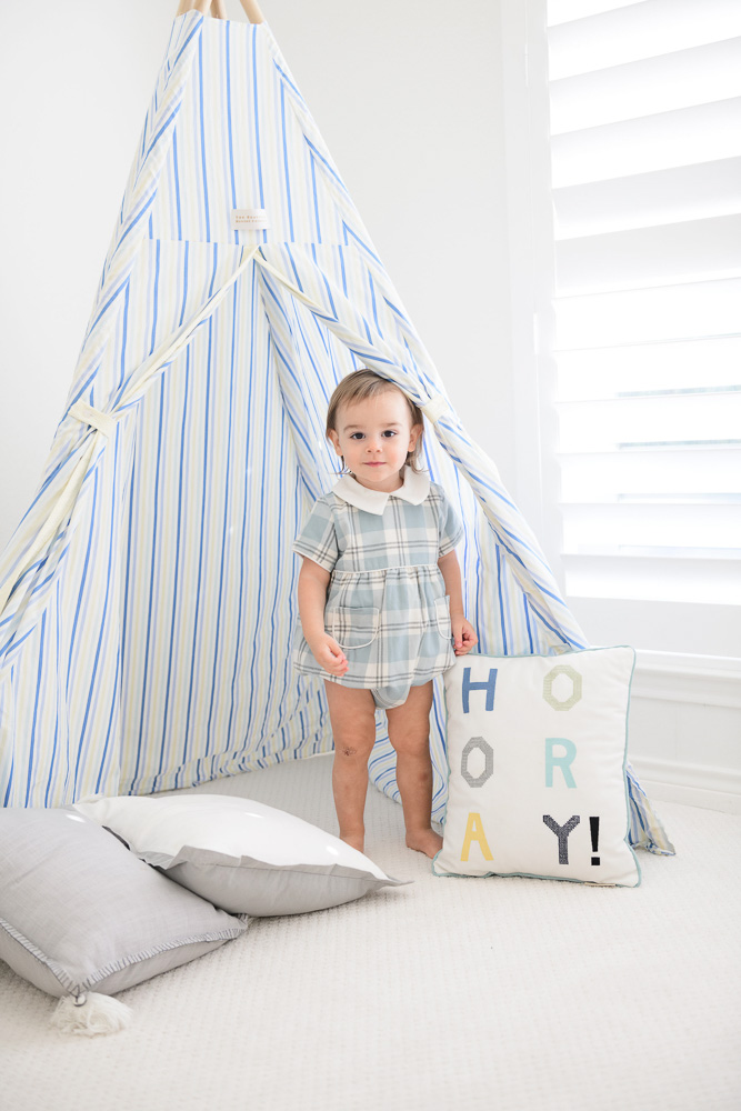 baby boy in play tent
