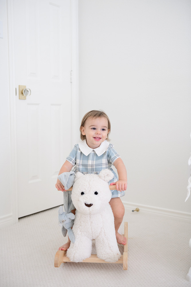 baby boy riding rocking bear