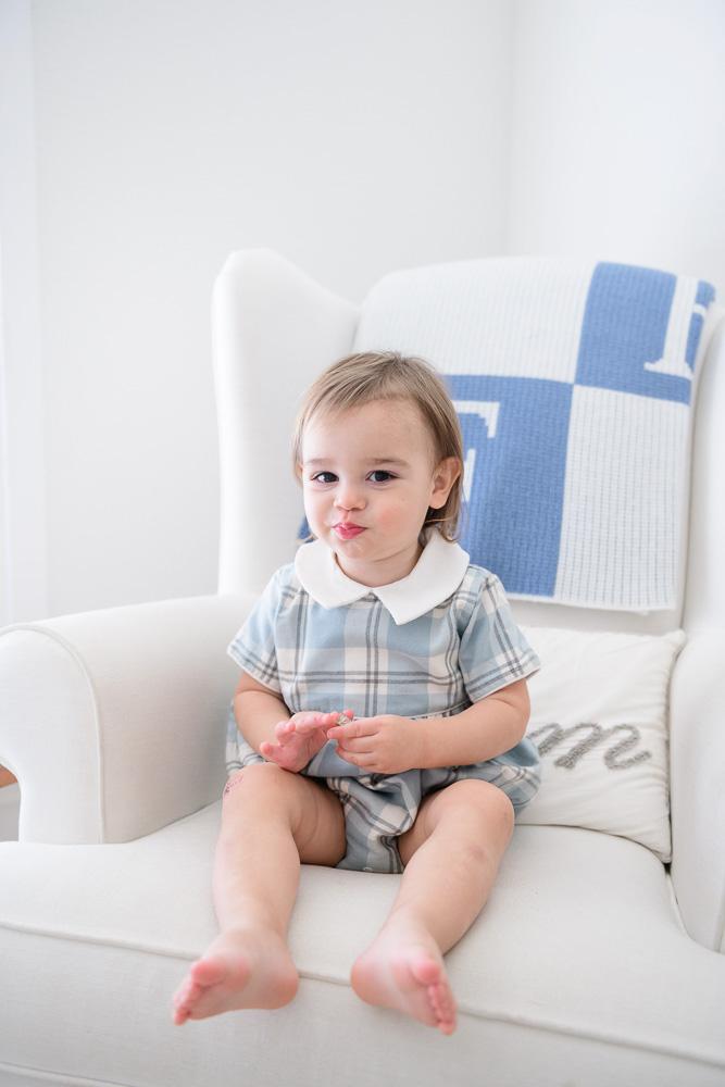 baby boy sitting in rocking chair
