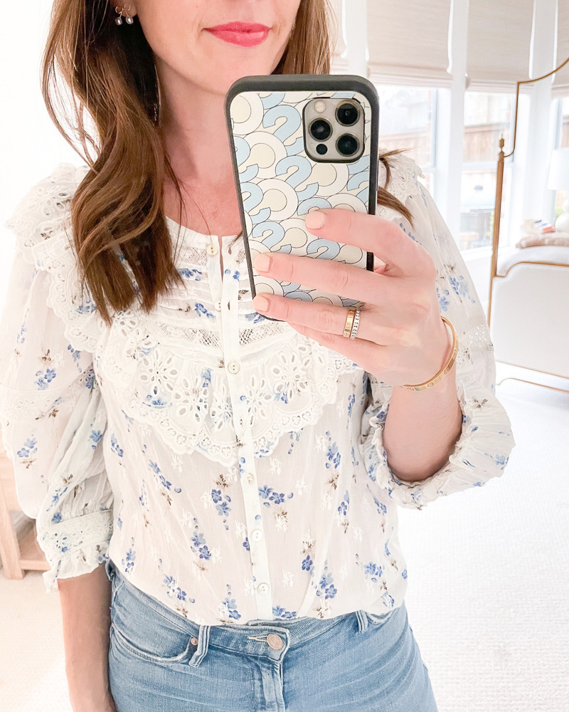 woman in mirror in floral top