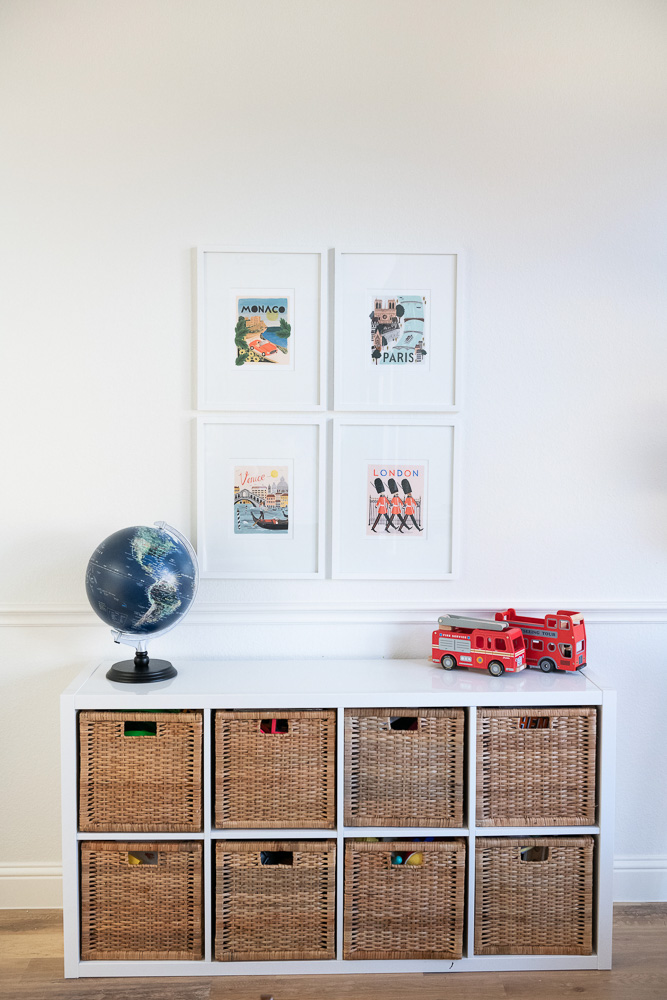 playroom with basket storage and travel prints