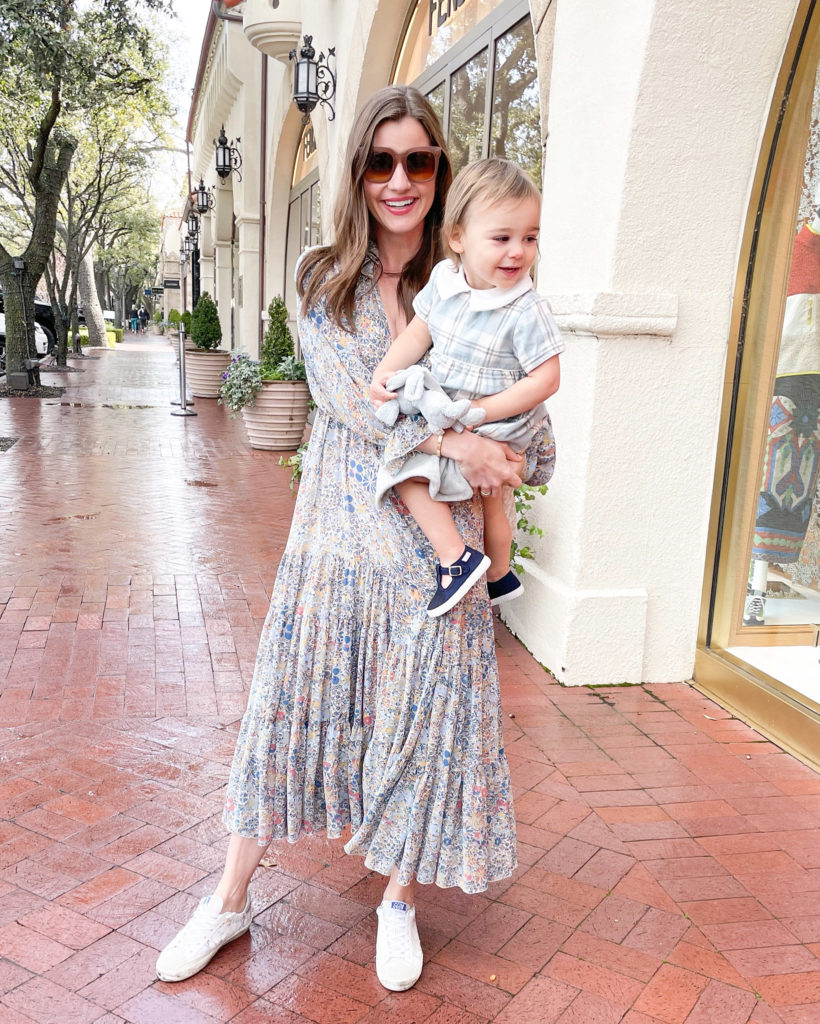 mom with baby flowy dress and sneakers