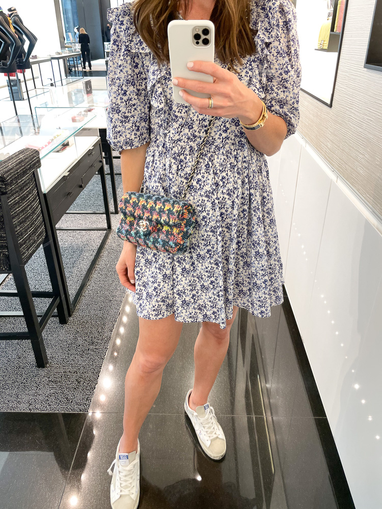 floral mini dress sneakers and tweed chanel bag