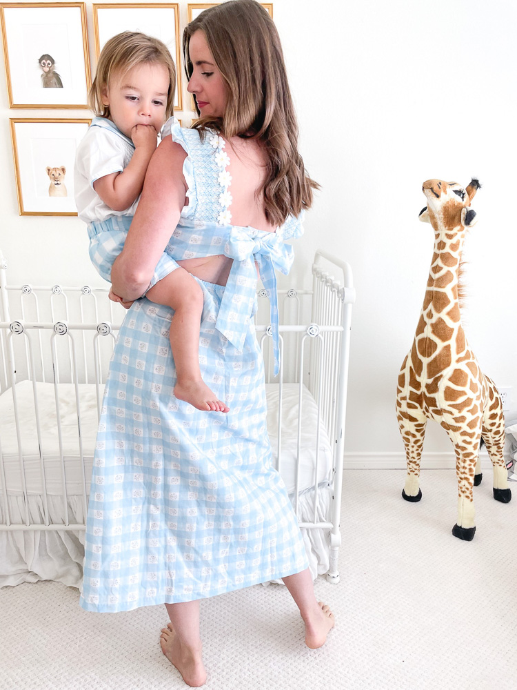 mom in gingham maxi dress holding toddler boy in matching shorts