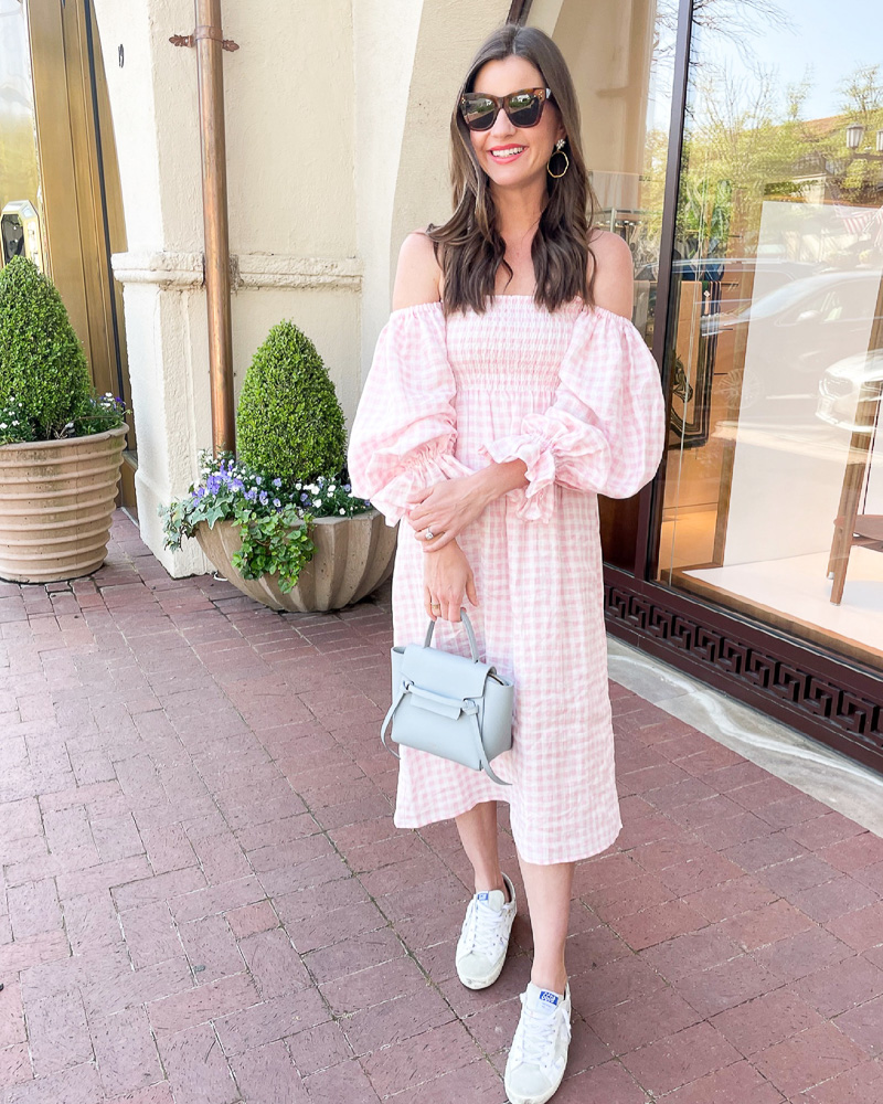 woman in pink gingham midi dress