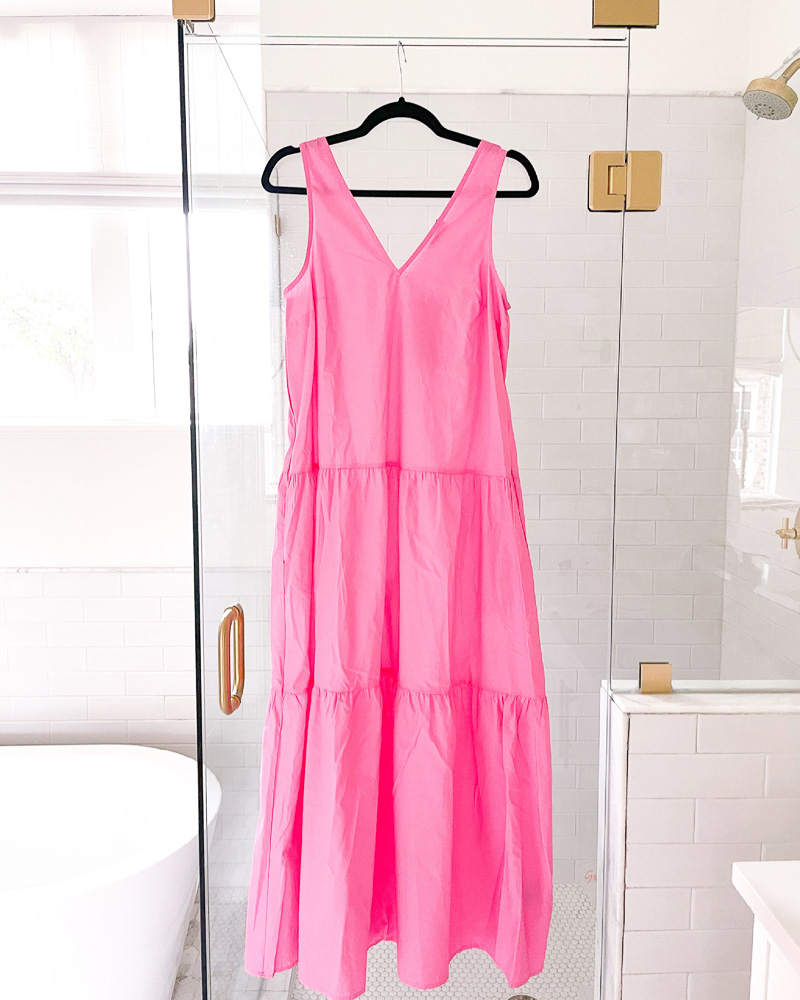 pink maxi dress hanging on shower door