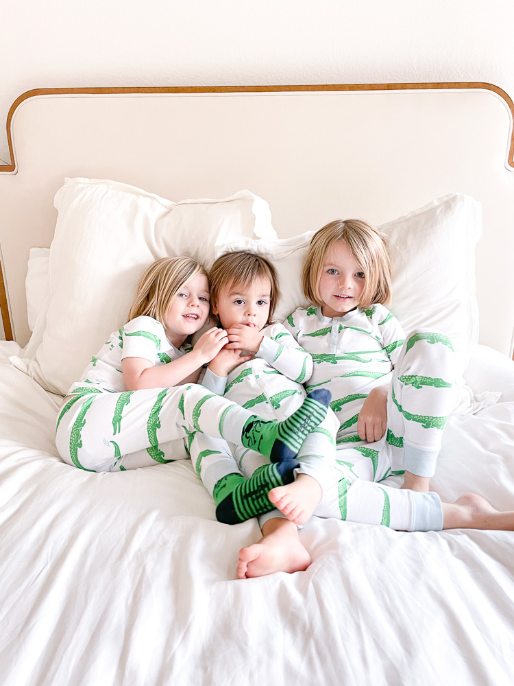 three little brothers in matching crocodile pajamas