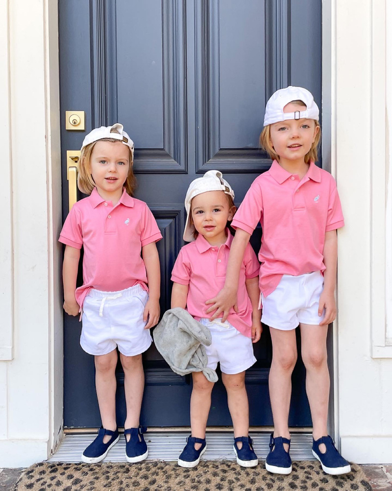 three little brothers pink polos white caps navy shoes