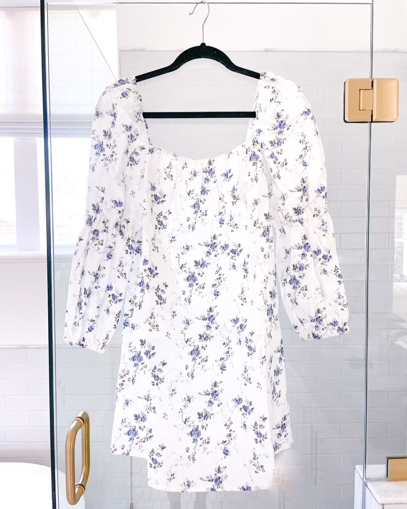 floral long sleeve mini dress hanging on shower door