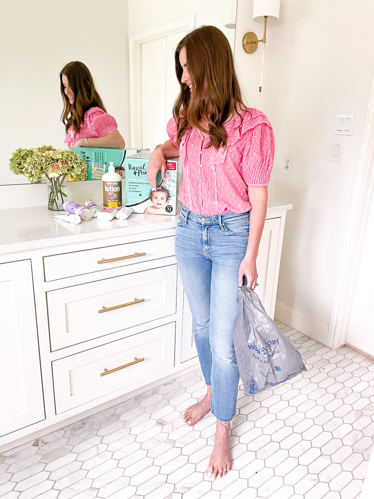 woman in bathroom with personal care products