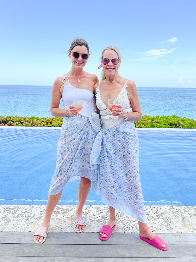 two women wearing sarongs poolside