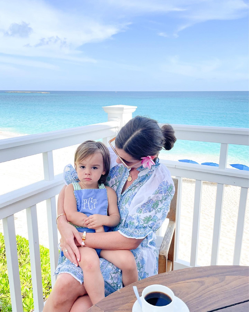 mom and toddler on patio overlooking ocean