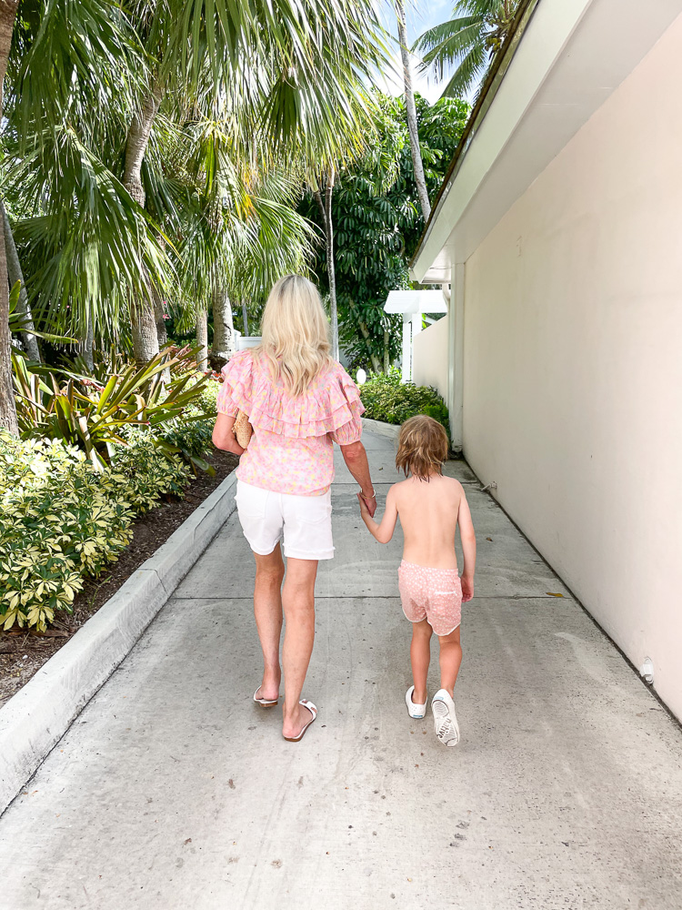 woman and toddler walking holding hands