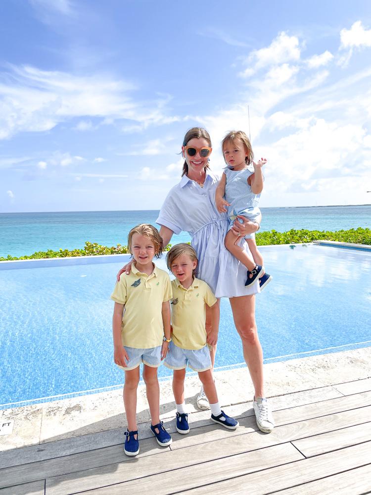 mom three toddler boys poolside overlooking ocean
