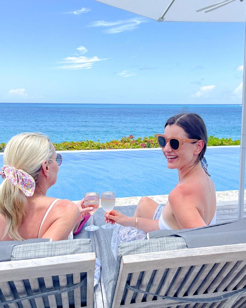 two women talking by pool