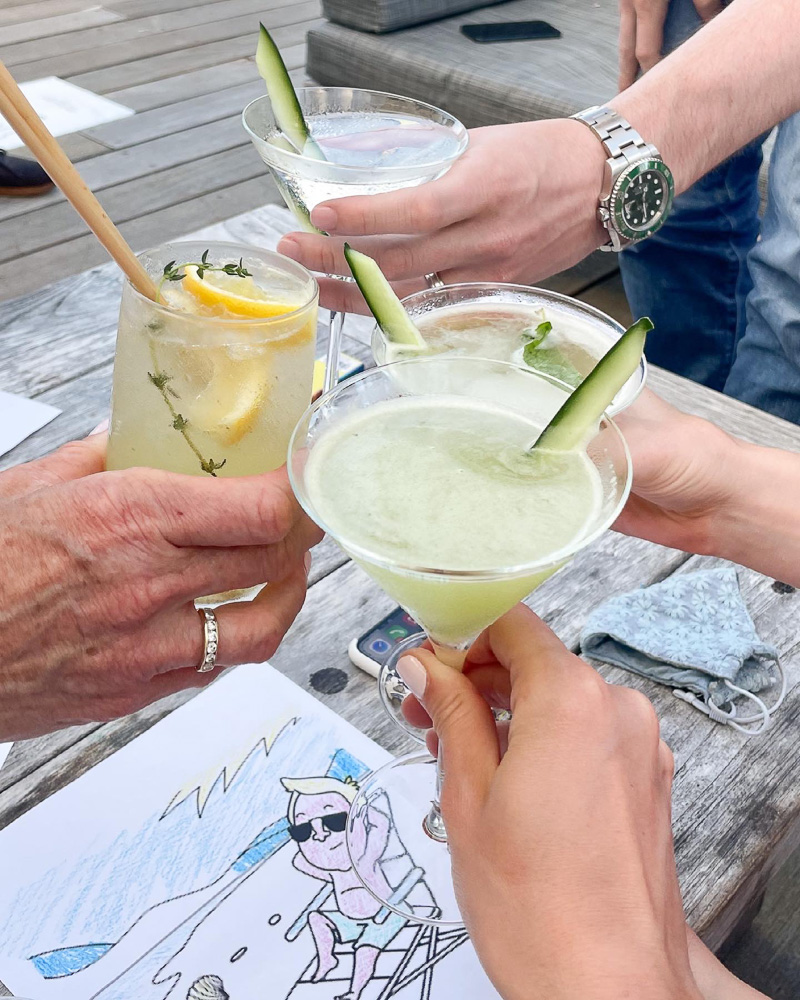 toasting with assorted cocktails