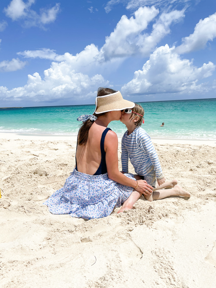 mom and toddler kissing on the bahamas beach