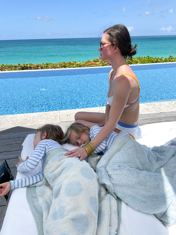 woman with two sleeping toddlers poolside the ocean club bahamas