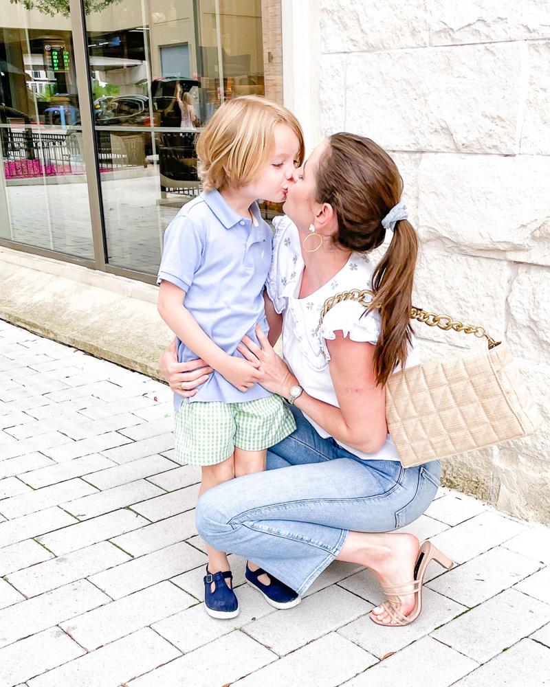 mom kissing toddler boy