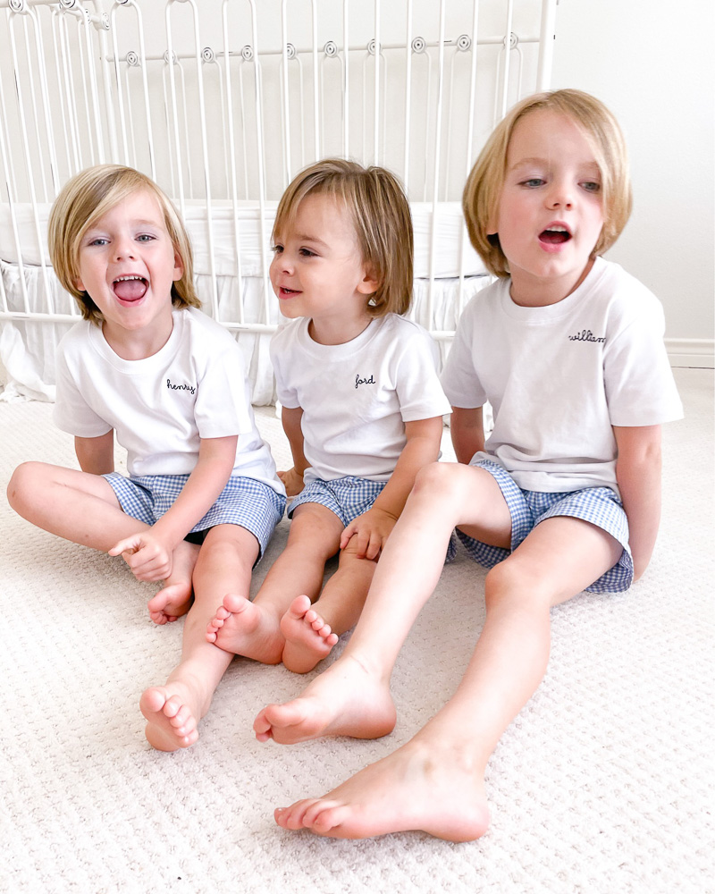three toddler brothers in matching outfits