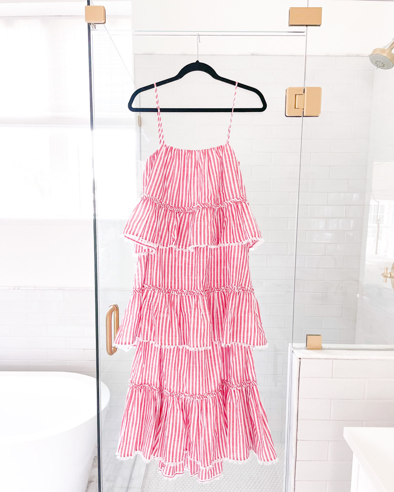 red and white striped maxi dress hanging on shower door