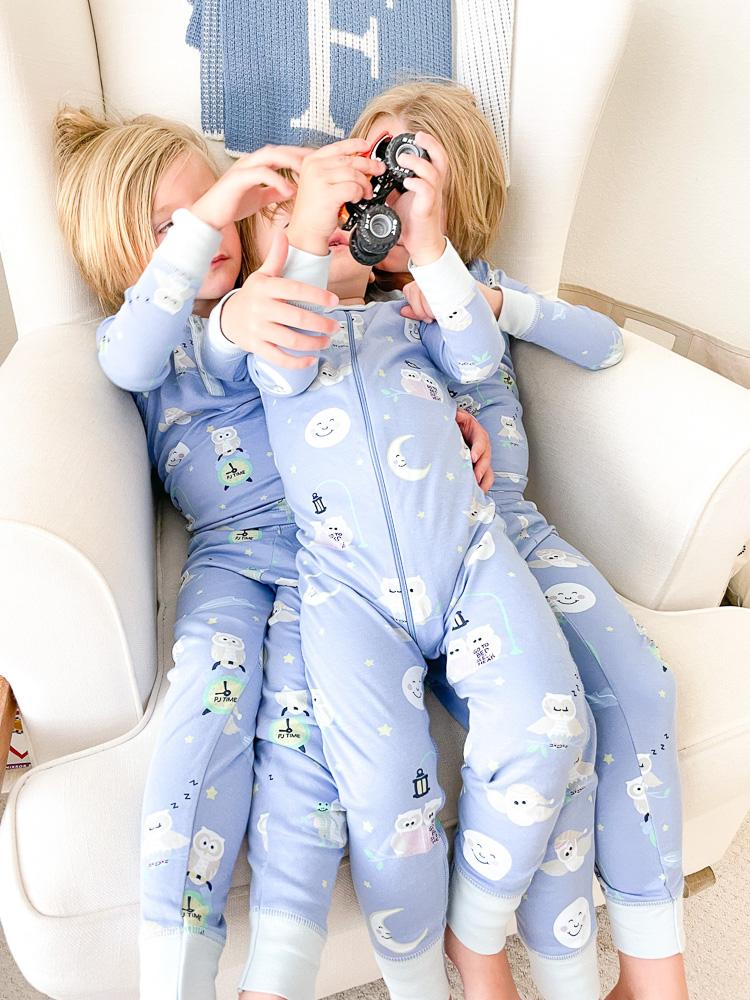 three brothers in matching pajamas