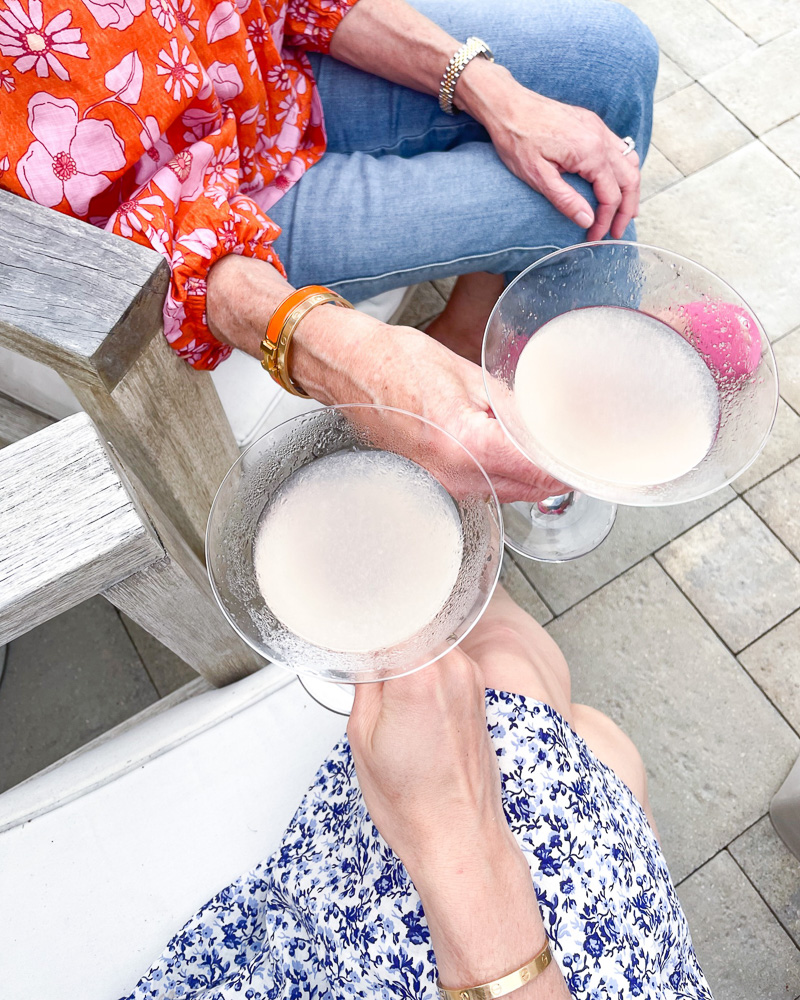 toasting with drinks on the patio