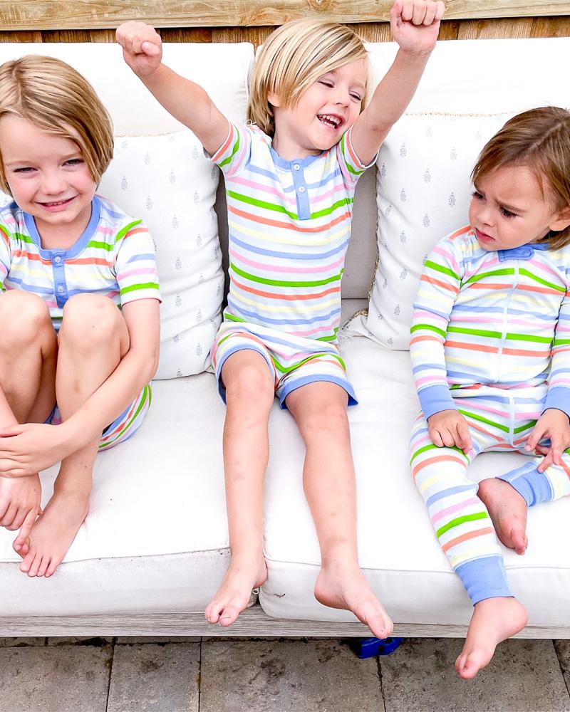 three toddler boys in matching pajamas
