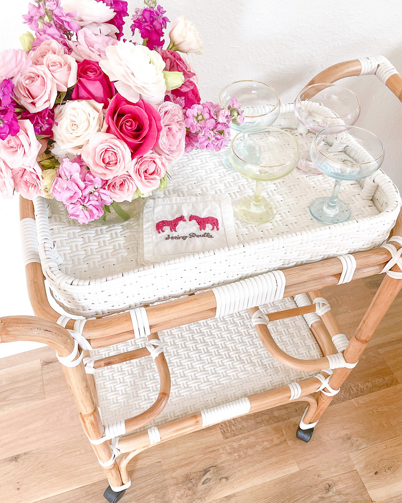 rattan bar cart champagne coupes flowers