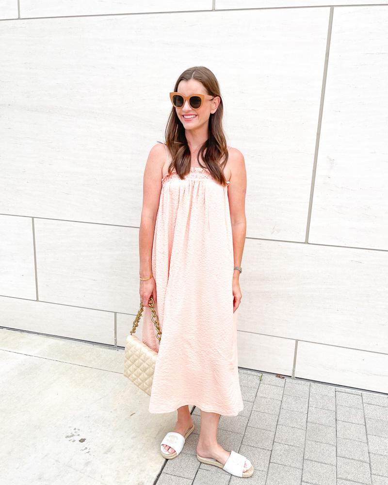 woman in peach maxi dress