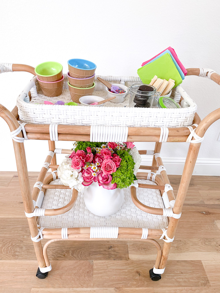 bar cart with colorful dishes and flowers