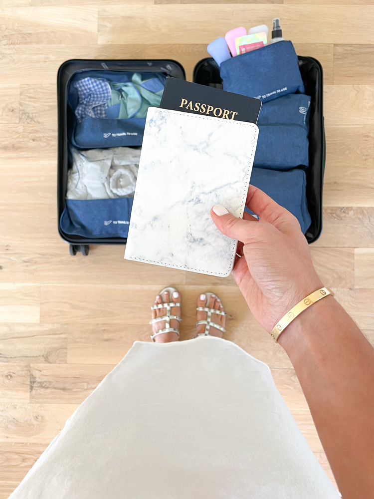 marbled passport cover packed suitcase