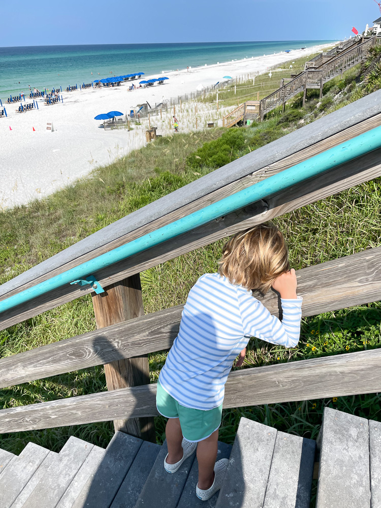 toddler boy looking out over 30A beach