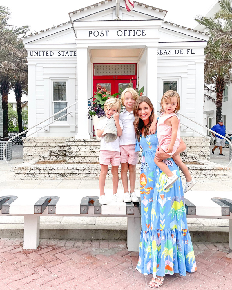 mom with three young sons in front of post office seaside Fl