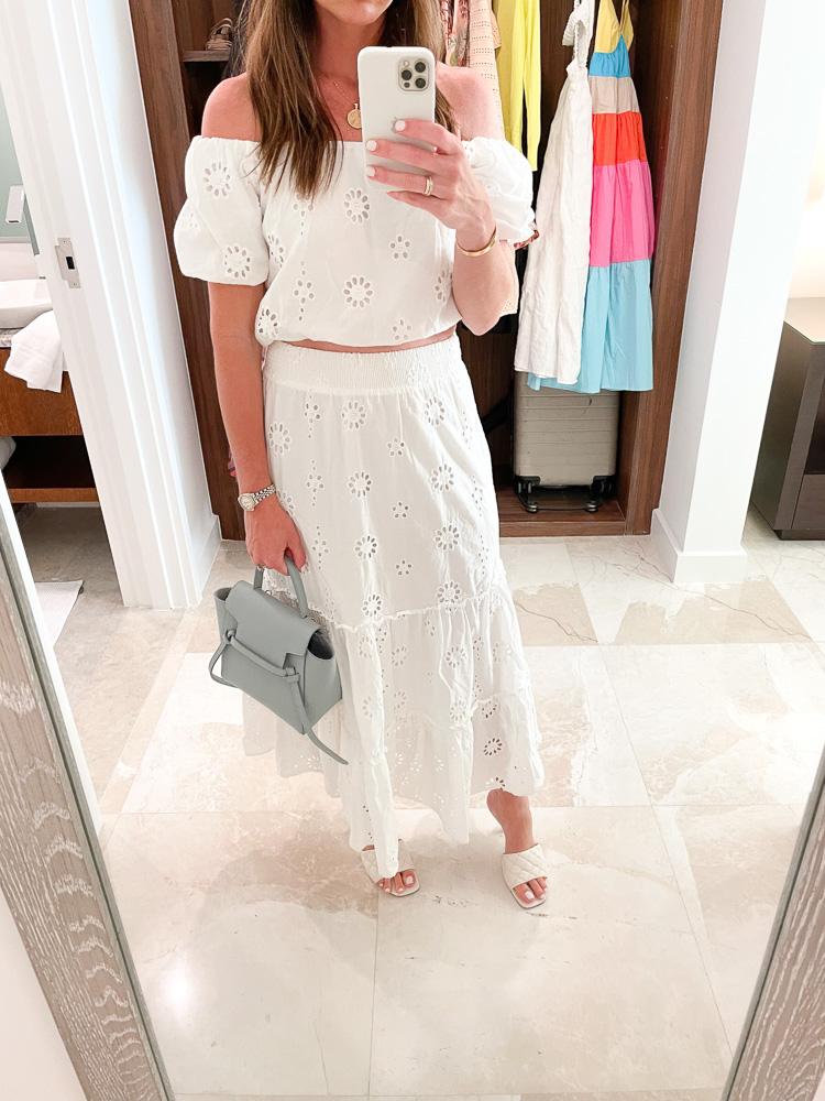 woman wearing matching eyelet skirt and top