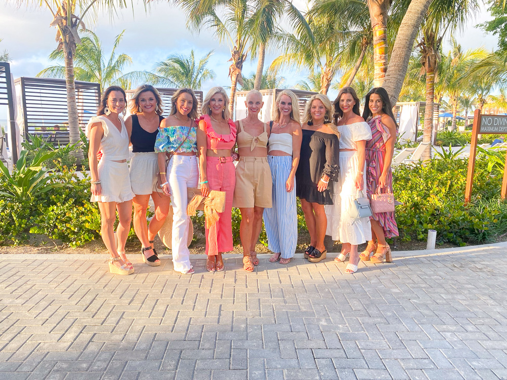 group of women dressed for dinner in the tropics