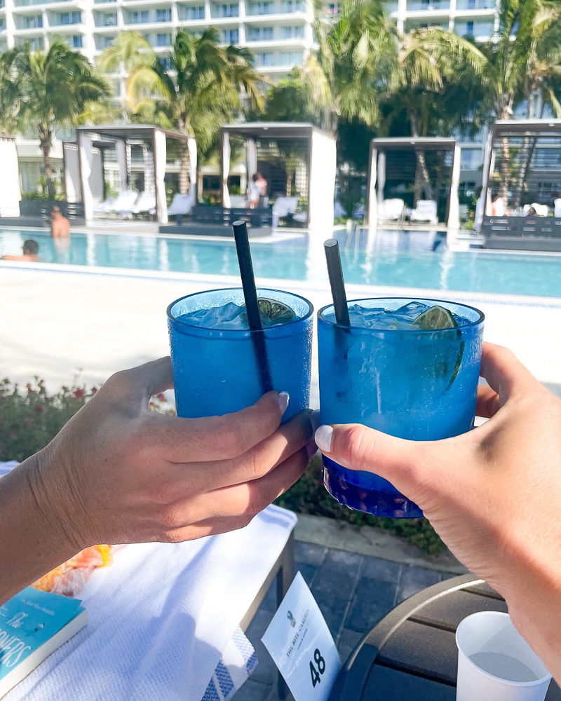toasting with blue cocktail glasses
