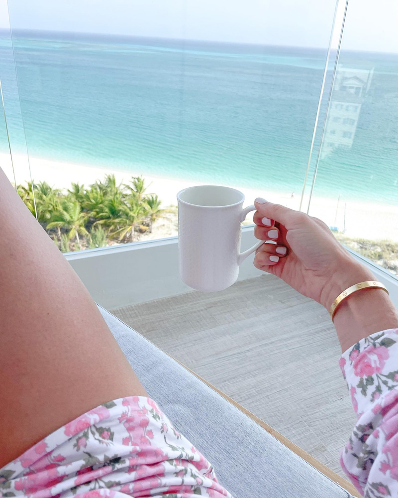 having coffee on balcony looking out to ocean