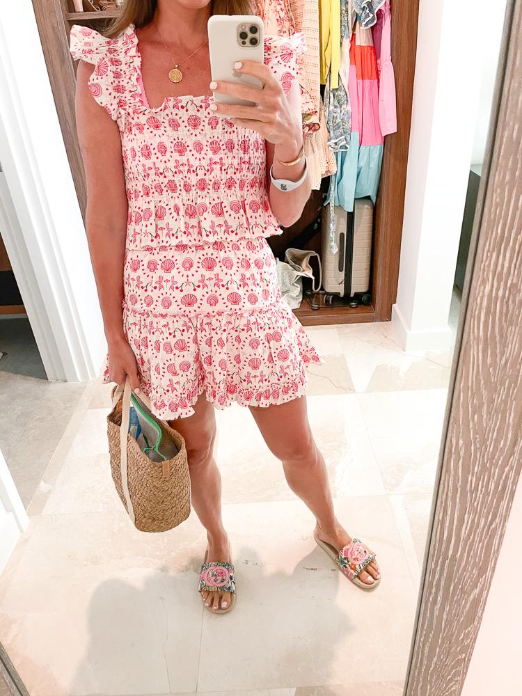 woman wearing matching crop top and mini skirt
