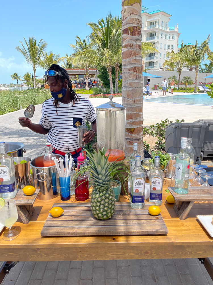 bartender making cocktails in the tropics