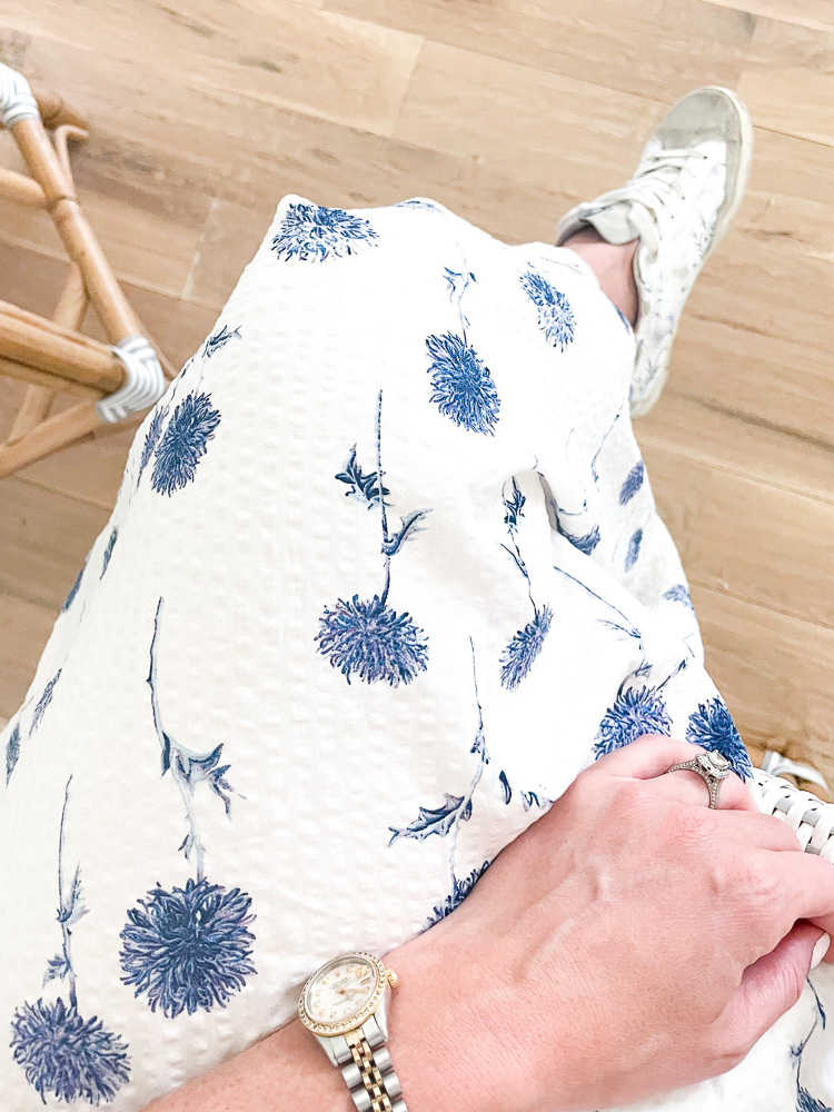 navy and white floral dress and sneakers