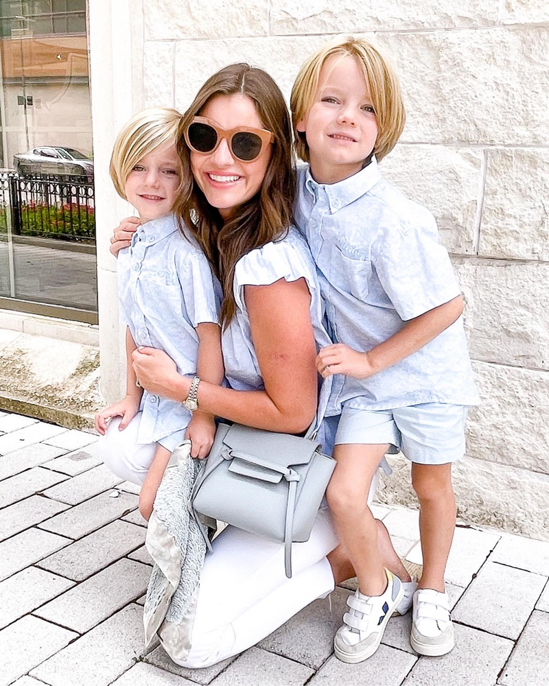 mom with two little boys in matching outfits