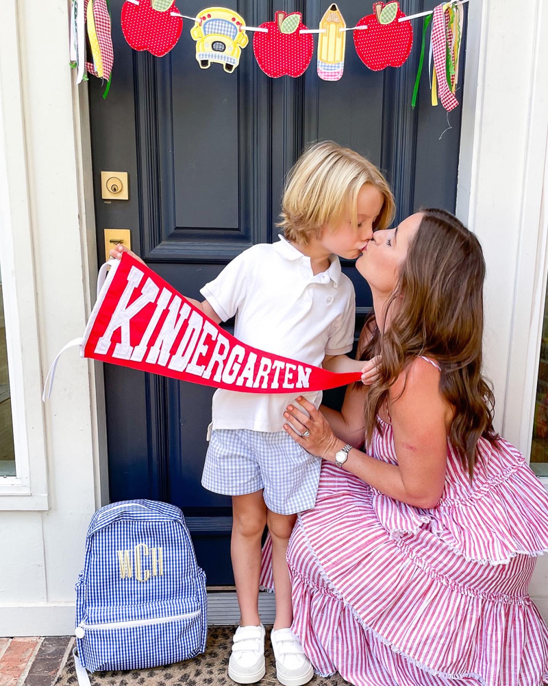 boy kissing mom on porch first day of kindergarten