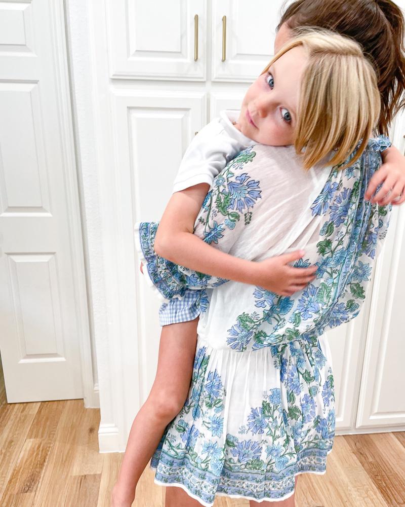 mom holding little boy on her shoulder