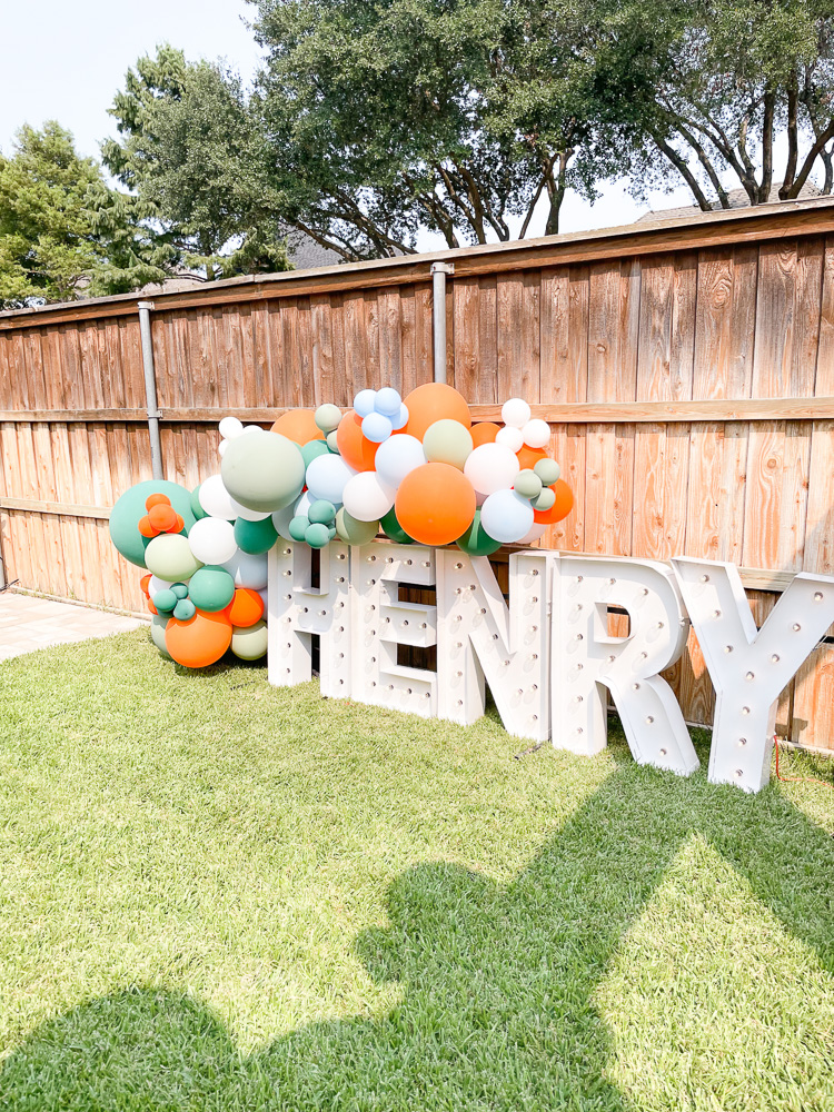 henry marquee sign with balloon garland